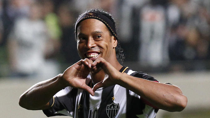 In this July 11, 2013 file photo, Brazil's Atletico Mineiro's Ronaldinho celebrates his team's victory over Argentina's Newell's Old Boys at the end of a Copa Libertadores semifinal soccer match in Belo Horizonte, Brazil. Ronaldinho was selected as best player in the Americas in 2013 by Uruguayan newspaper El Pais, which surveyed hundreds of journalists from around the continent
