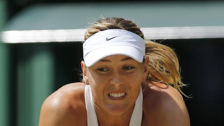 Maria sharapova of russia returns to angelique kerber of germany