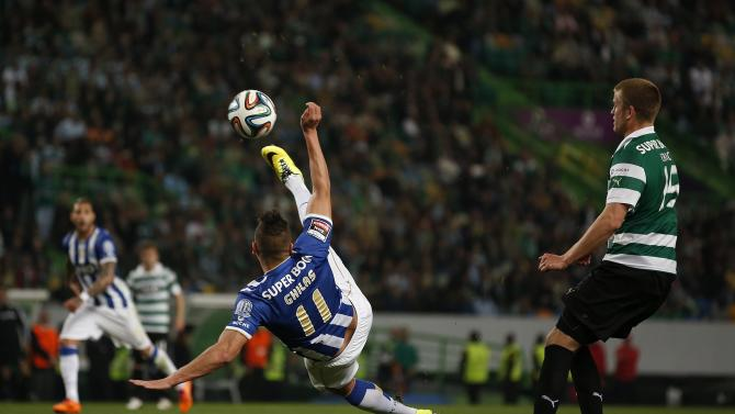 Porto's Nabil Ghilas shoots near Sporting's Eric Dier during their Portuguese premier league soccer match at Alvalade stadium in Lisbon
