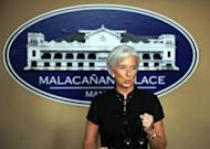 Christine Lagarde, International Monetary Fund (IMF) managing director speaks at a press conference in Manila. Lagarde urged the Philippines on Friday to tax mobile phone messages to shore up state funds in a country sometimes called the world's text message capital