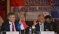 Indonesia's Defence Minister Purnomo Yusgiantoro (R) speaks to journalists next to Australia's Defence Minister Stephen Smith during a press conference in Jakarta. During meetings between the two countries, Indonesia's justice minister said that his country would extradite human trafficking kingpin Sayed Abbas to Australia next year