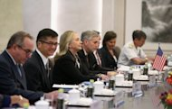 US Secretary of State Hillary Clinton (3rd L) at the Ministry of Foreign Affairs in Beijing. Clinton's trip comes before elections in the US, where Barack Obama's Republican challenger Mitt Romney has vowed a tougher stance on China over its currency rate and its military build-up