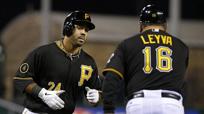 Alvarez powers Pirates by Cardinals 12-2