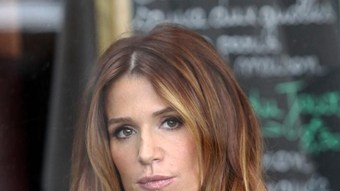Poppy Montgomery is enjoying a coffee at Cafe Parisien
