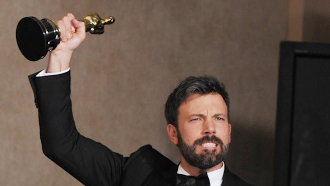 "FILE - In this Feb. 24, 2013 file photo, Ben Affleck poses with his award for best picture for ""Argo"" during at the Oscars at the Dolby Theatre, in Los Angeles. Affleck discusses his awkward Oscar speech and remembers film critic Roger Ebert on Tuesday, April 9, 2013, at the Los Angeles premiere of ""To the Wonder."" (Photo by John Shearer/Invision/AP, File)"