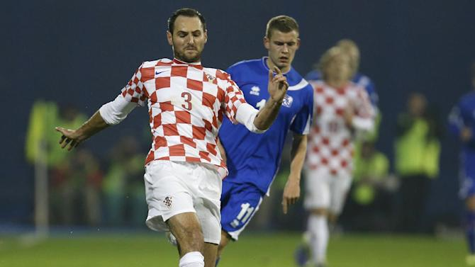 "In this Nov. 19, 2013 file picture Croatia's defender Josip Simunic, left, is challenged by Iceland's Alfred Finnbogason during their World Cup qualifying playoff second leg soccer match against Iceland, in Zagreb, Croatia. Croatia's World Cup qualification celebrations have been marred by apparent pro-Nazi chants by fans and defender Joe Simunic. Croatia qualified for the World Cup with a 2-0 win over Iceland on Tuesday. Video footage shows Simunic taking a microphone to the field after the match and shouting to the fans: ""For the homeland!"" The fans respond: ""Ready!"" That was the war call used by the Croatian pro-Nazi puppet regime that ruled the state during World War II when tens of thousands Jews, Serbs and others perished in concentration camps. The Australian-born Simunic defended his action, saying ""some people have to learn some history."""