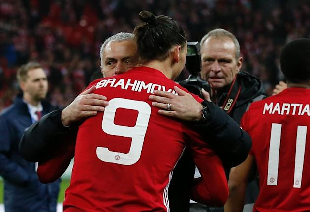 Manchester United's Zlatan Ibrahimovic embraces team manager Jose Mourinho after their victory in the English League Cup final match against Southampton, at Wembley stadium in London, on February
