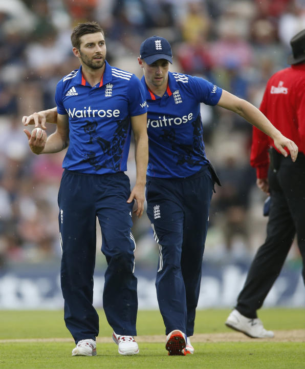 England's Chris Woakes and Mark Wood