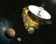 Vue d'artiste fournie par la NASA/Université Johns Hopkins de la sonde New Horizons s'approchant de Pluton