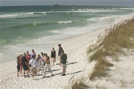 Couple get married before the possible arrival of Tropical Storm Karen in Navarre Beach