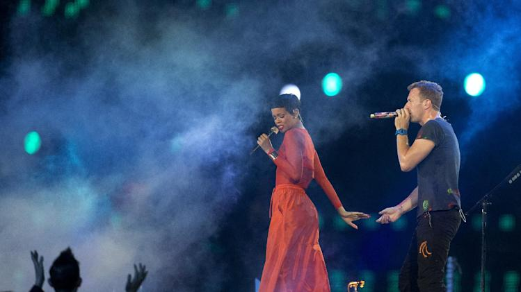 Singer Rihanna performs with Chris Martin lead vocals of the British rock band Coldplay during the closing ceremony for the 2012 Paralympics games, Sunday, Sept. 9, 2012, in London. (AP Photo/Matt Dunham)