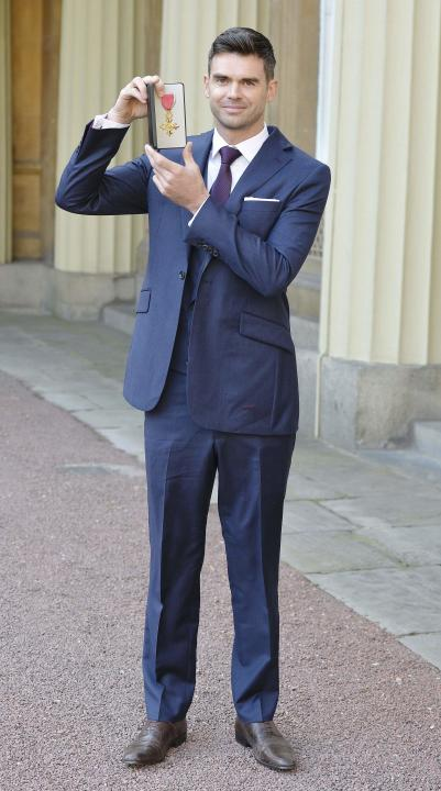 England cricket player James Anderson poses for pictures at Buckingham Palace, London, after he was made an OBE (Officer of the Order of the British Empire) by the Prince of Wales for services to cric