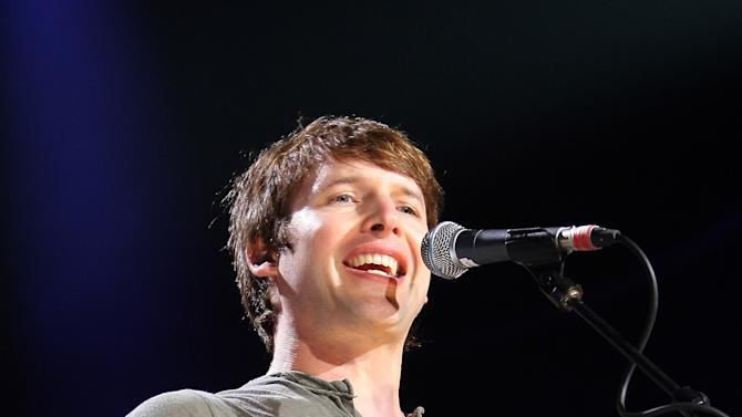 "FILE - In this Sunday, April 3, 2011 file photo British singer-songwriter James Blunt performs on stage at ""Le Liberte"" in Rennes, western France. James Blunt was among 17 hacking victims who settled Friday Feb. 8, 2013 with News Corp. subsidiary News Group Newspapers over its campaign of illegal espionage, which set off a massive scandal when it was revealed in July 2011. (AP Photo/David Vincent, File)"