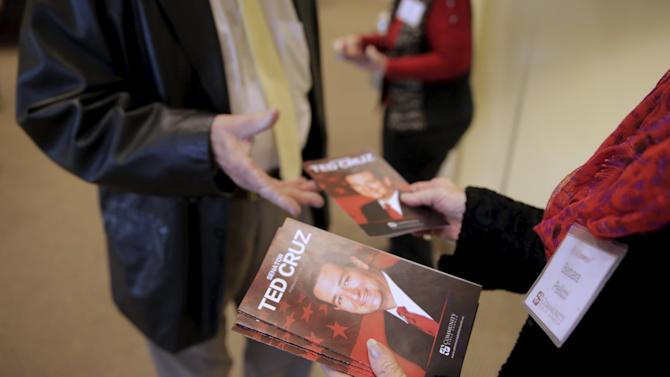 An usher hands out programs featuring Republican presidential candidate Senator Cruz at the Community Bible Church in Beaufort