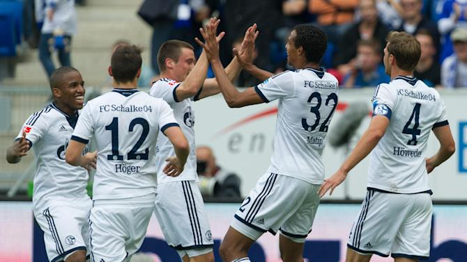 Schalke's Joel Matip, second right, celebrates with teammates after scoring during the German first division Bundesliga soccer match between TSG 1899 Hoffenheim and Schalke 04 in Sinsheim, Germany, Saturday, Sept. 28, 2013