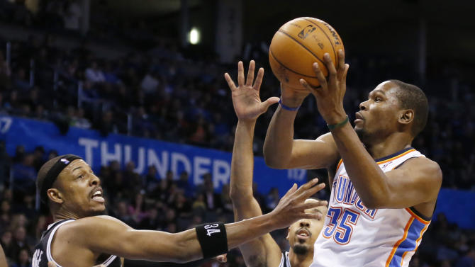 Oklahoma City Thunder forward Kevin Durant (35) shoots in front of Brooklyn Nets forward Paul Pierce (34) in the third quarter of an NBA basketball game in Oklahoma City, Thursday, Jan. 2, 2014. Oklahoma City won 95-93