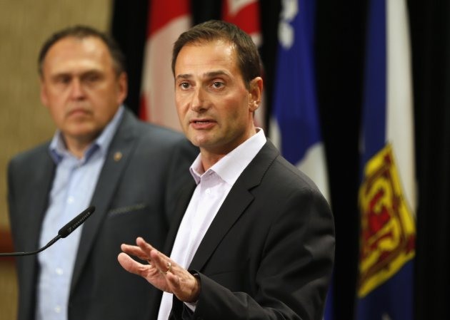 Robert Ghiz, premier of Prince Edward Island (R) during a news conference on August 28, 2014. (Reuters)