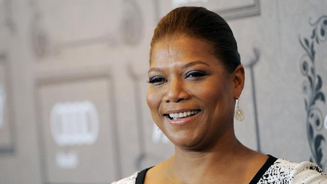 """FILE - This Oct. 5, 2012 file photo shows Queen Latifah at Variety's 4th annual Power of Women event in Beverly Hills, Calif. Latifah's new talk show, """"The Queen Latifah Show"""" comes out from Sony Pictures Television in September 2013. (Photo by Chris Pizzello/Invision/AP, file)"""