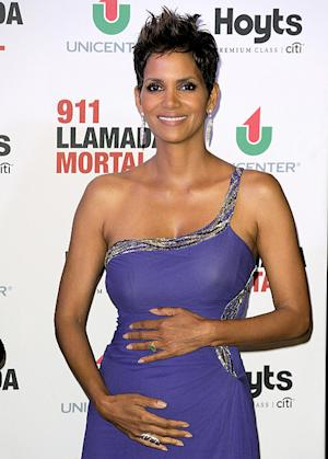 Halle Berry Caresses Baby Bump in Gorgeous Purple Gown