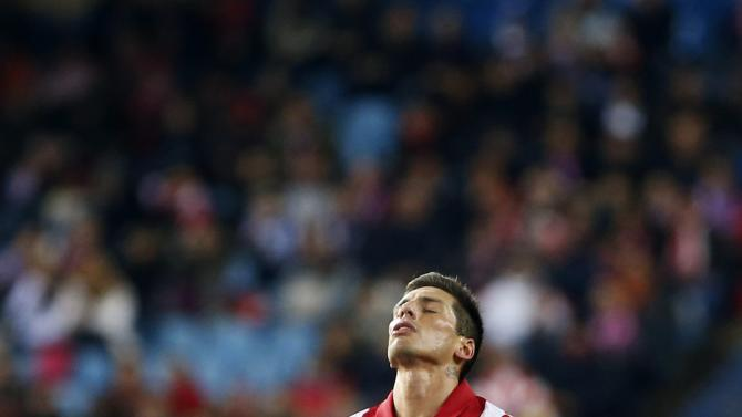 Atletico Madrid's Sosa reacts after a missed scoring opportunity against Real Madrid during their Spanish King's Cup semi-final second leg soccer match in Madrid