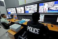 Security officers in Bangkok monotor CCTV cameras on July 2, 2010. Thai police said they had Wednesday arrested a man for the rape of a 20-year-old Scottish woman who had hoped to work as an English teacher in the Southeast Asian country. The 25-year-old Thai suspect was arrested in the southern city of Nakhon Si Thammarat based on evidence fromCCTV cameras and witness accounts, officials said