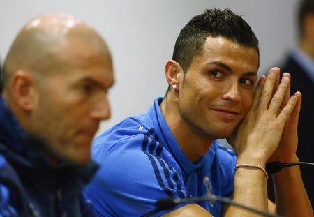 Real Madrid's Ronaldo and coach Zidane attend a news conference prior to their Champions League soccer match against AS Roma at the Olympic stadium in Rome