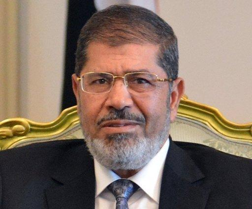 """Egypt's Islamist President Mohamed Morsi, seen here on September 4, has slammed """"attacks"""" on the Muslim prophet Mohammed in a film on Islam that sparked an outcry in Egypt, while also stressing that he condemned violence"""