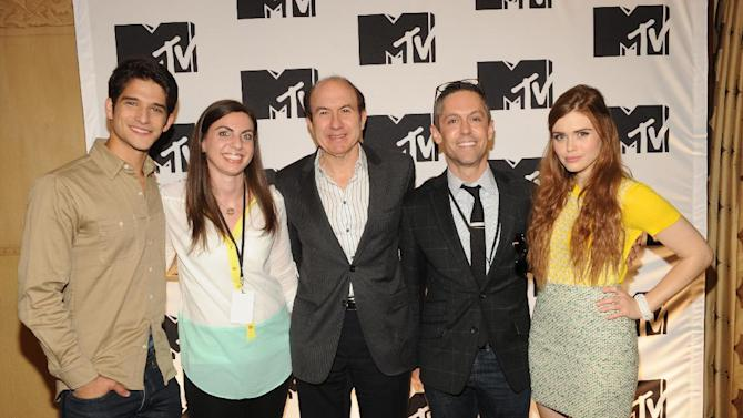 "From left, Tyler Posey of ""Teen Wolf"", Darcy Bowe from Starcom, Philippe Dauman President and CEO Viacom, xxxxx, Holland Roden of ""Teen Wolf"" arriving at the 2013 MTV Upfront, on Thursday, April 25, 2013 at the Beacon Theater in New York. (Photo by Scott Gries/Invision/AP Images)"