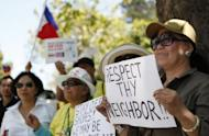 Anti-China protesters gather outside of Chinese consulate in San Francisco on May 11, to protest an escalating territorial dispute over the Scarborough Shoal in the South China Sea. The United States and the Philippines called for freedom of navigation in the tense South China Sea as the White House offered a robust show of support for President Benigno Aquino