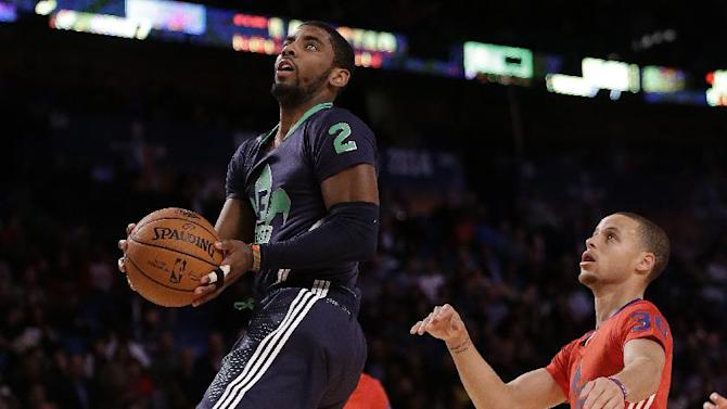 East Team's Kyrie Irving, of the Cleveland Cavaliers (2) goes to the hoop against the West Team during the NBA All Star basketball game, Sunday, Feb. 16, 2014, in New Orleans