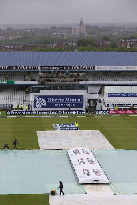 Covers are seen on the pitch as rain falls before play on the first day of the second Test cricket match between England and New Zealand at Headingley cricket ground in Leeds, England, Friday, May 29,