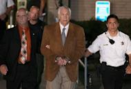 Former Penn State assistant football coach Jerry Sandusky leaves court in handcuffs after being convicted in his child sex abuse trial at the Centre County Courthouse in Pennsylvania on June 22. The jury found Sandusky guilty on 45 of 48 counts in the child sex abuse case that shocked the nation