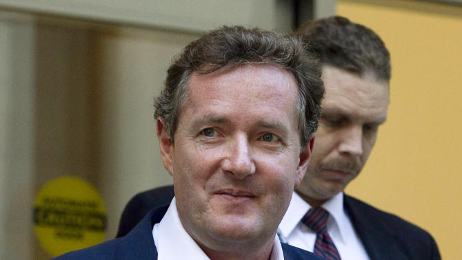 """FILE - In this Dec. 20, 2011 file photo, Piers Morgan, host of CNN's """"Piers Morgan Tonight,"""" leaves the CNN building in Los Angeles.  More than 31,400 people have signed a petition calling for British CNN host Piers Morgan to be deported from the U.S. over his gun-control views. Morgan has taken an aggressive stand for tighter U.S. gun laws in the wake of the Newtown, Conn., school shooting. Last week, he called a gun advocate appearing on his """"Piers Morgan Tonight"""" show an """"unbelievably stupid man."""" Now, gun-rights activists are fighting back. A petition created Dec. 21 on the White House e-petition website by a user in Texas accuses Morgan of engaging in a """"hostile attack against the U.S. Constitution"""" by targeting the Second Amendment and demands he be deported immediately.  (AP Photo/Jae C. Hong, File)"""