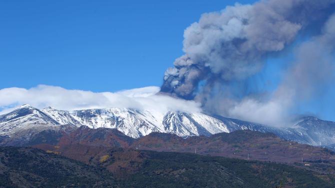 Smoke billows from the Mount Etna, Europe's tallest active volcano, Sicily, Saturday, Nov. 23, 2013. (AP Photo/Carmelo Imbesi)