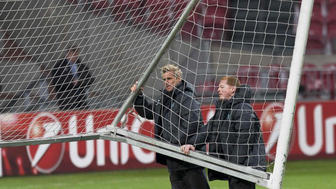 Celtic manager Neil Lennon and assistant coach Johan Mjallby during a training session in Amsterdam