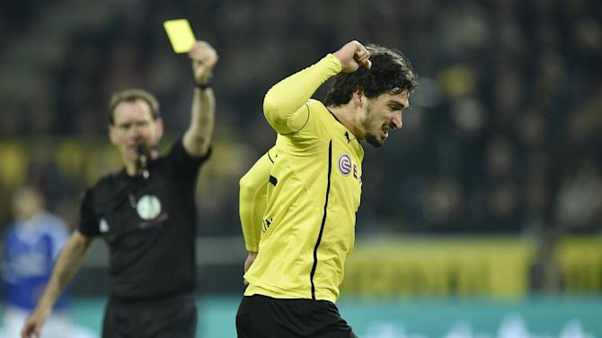 Dortmund's Mats Hummels reacts during  the German Bundesliga soccer match between Borussia Dortmund and FC Schalke 04 in Dortmund,  Germany, Tuesday, March 25, 2014