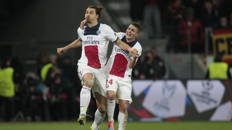Paris St. Germain's Zlatan Ibrahimovic and Marco Verratti celebrate a goal against Bayer Leverkusen during their Champions League soccer match in Leverkusen