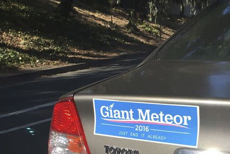 """A U.S. election campaign-themed bumper sticker reading """"Giant Meteor 2016"""" is seen in Oakland"""