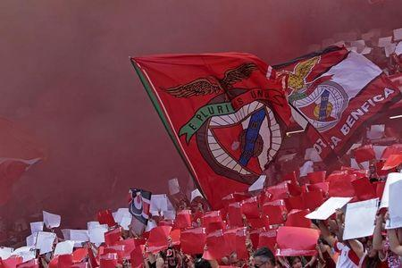 Benfica's supporters hold Benfica flag and flares before their Portuguese Premier League soccer match against Penafiel held at Luz stadium in Lisbon