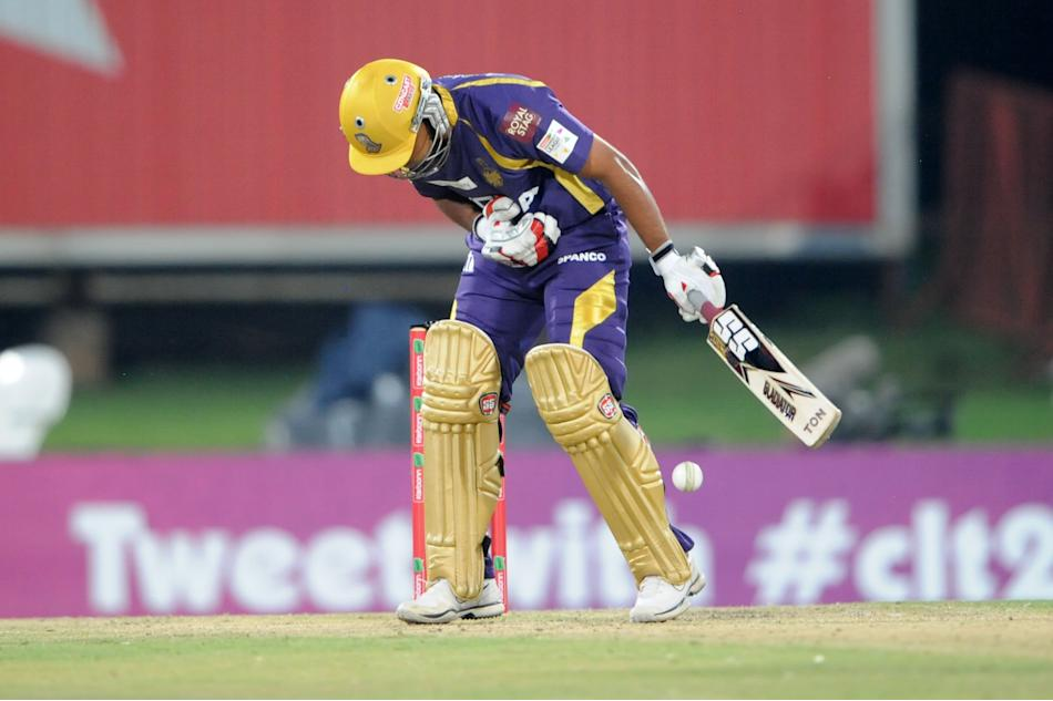 PRETORIA, SOUTH AFRCA - OCTOBER 13:  Rajat Bhatia of the Knight Riders reacts after being hit by a ball from Morne Morkelof the Daredevils during the Karbonn Smart CLT20 match between Kolkata Knight R