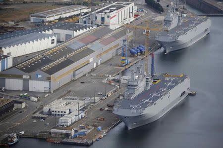 The two Mistral-class helicopter carriers Sevastopol and Vladivostok are seen at the STX Les Chantiers de l'Atlantique shipyard site in Saint...