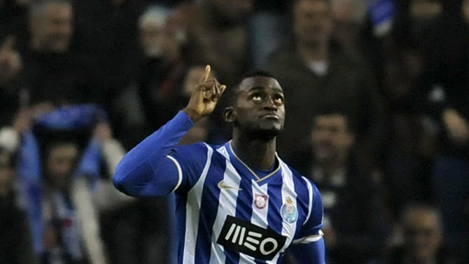 FC Porto's Jackson Martinez from Colombia celebrates after scoring the opening goal against Benfica in a Portugal Cup semifinal first leg soccer match at the Dragao stadium in Porto, Portugal, Wednesday, March 26, 2014