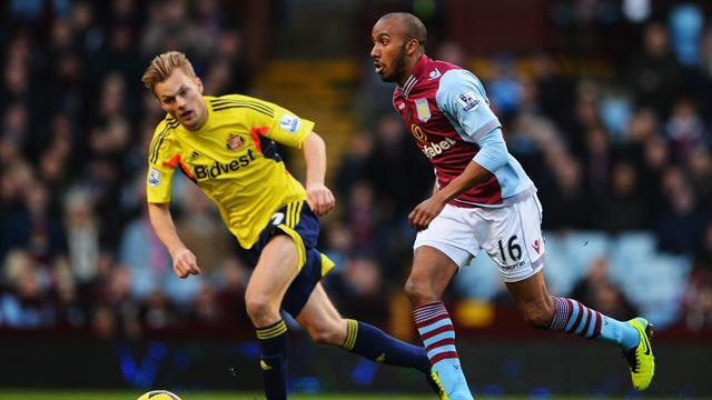 Premier League - Lambert defends Delph style