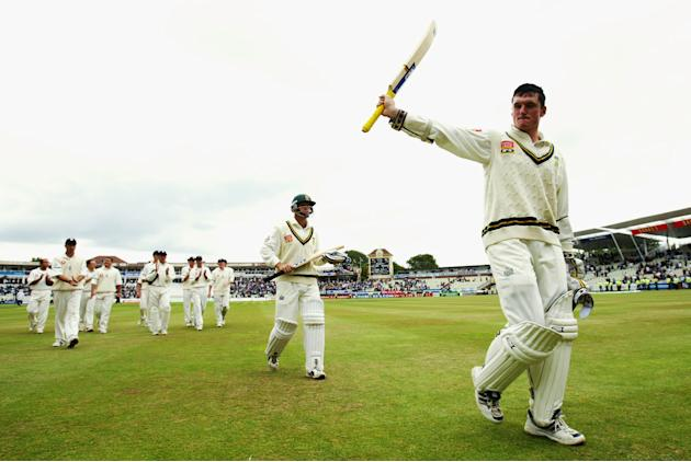 Graeme Smith of South Africa walks off with his team-mate Gary Kirsten