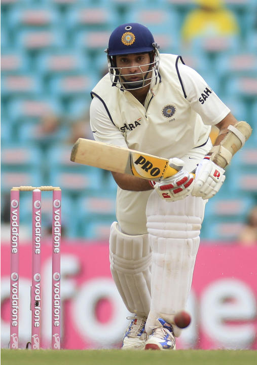 India's VVS Laxman watches his drive while batting against Australia on the fourth day in their cricket test match at the Sydney Cricket Ground in Sydney, Friday, Jan. 6, 2012. (AP Photo/Rick Rycr