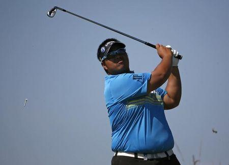 Kiradech Aphibarnrat of Thailand watches his tee shot during the first round of the British Open Championship at the Royal Liverpool Golf Club in Hoylake