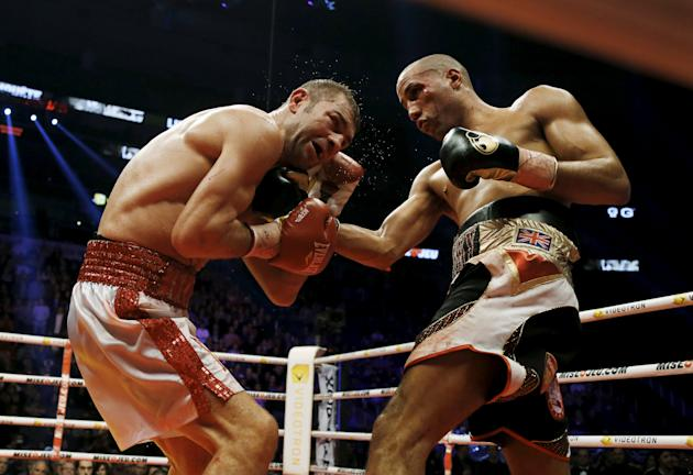 Lucian Bute of Canada takes a punch from James DeGale of Britain during their IBF super middleweight title boxing match in Quebec City