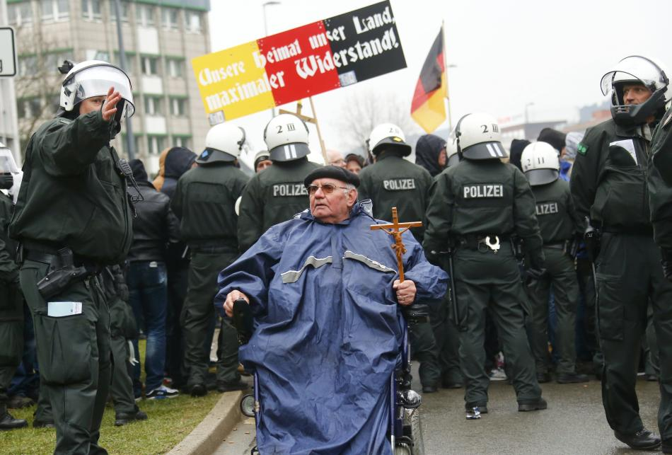 A protester of an anti-Muslim grassroots movement leaves an anti-Islamists demonstration in Wuppertal