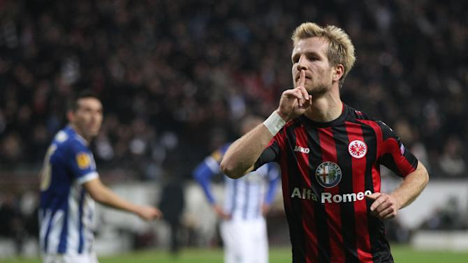 Frankfurt's Stefan Aigner celebrates his side's opening goal during a Europa League round of 32 second leg soccer match between Eintracht Frankfurt and FC Porto in Frankfurt, Germany, Thursday, Feb. 27, 2014