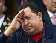 Venezuelan President Hugo Chavez salutes during a ceremony at Caracas' Miraflores Palace, on June 2, 2012. With Chavez ailing and absent, Venezuela's leftist government launches a new presidential term with a display of popular support on the day he was to be inaugurated